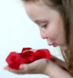 girl blowing rose petals - dreamy