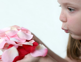 girl blowing rose petals 2