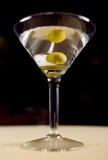 vodka martini with olive in a glass