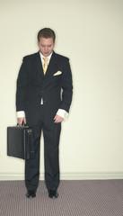 businessman looks down