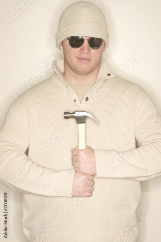 man smiles with hammer