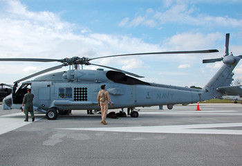 navy helicopter preparation for flight