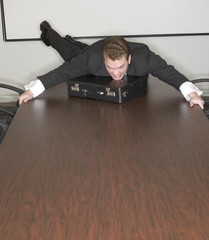 businessman jumps on table
