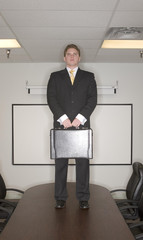 businessman stands on table