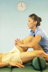 massage therapist massaging leg