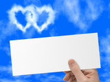postcard in hand, blue sky and heart-shaped clouds poster
