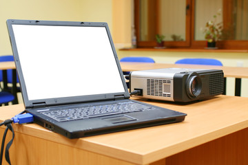 laptop connected to projector on table