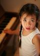 child profile at piano