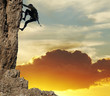 canvas print picture rock climber on sunset background