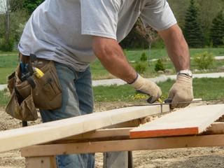 carpenter prepares to cut