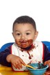 baby boy with chocolate pudding face