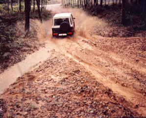 truck on the muddy dirt road