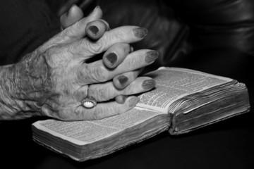 senior's hands in prayer