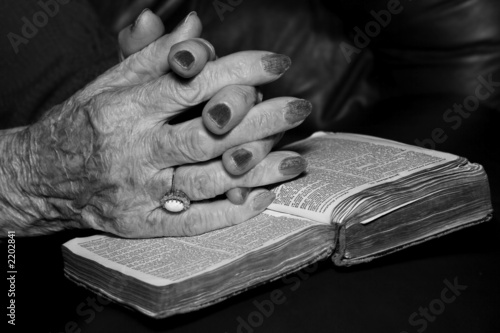 senior's hands in prayer
