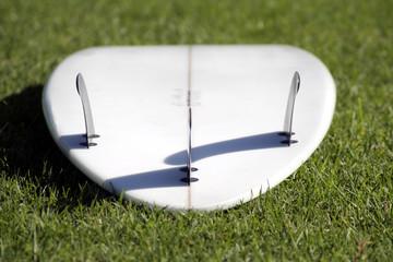 white surfboard, fins