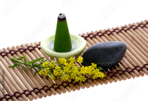 scent, pebble and flower on mat