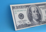 hundred dollar note on blue poster