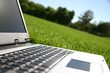 silver laptop on green grass