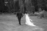 bride and groom walking holding hands black white poster