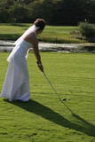 bride golfing in dress gown white poster