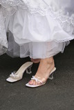 strap shoes and white dress gown elegant shoe poster