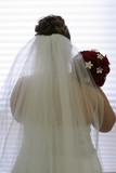 hair veil flowers back of white dress gown bride poster