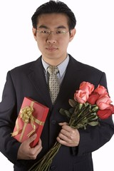 asian people with roses and present