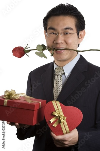 holding rose in mouth