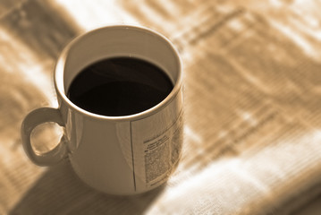 morning coffee and news  (sepia)