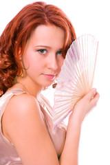 beauty redheaded girl with fan