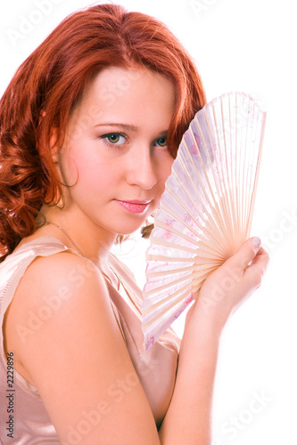 beauty redheaded girl with fan
