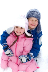 boy and girl on snow