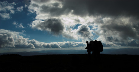 hikers' silhouettes