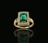 golden emerald & diamond ring poster