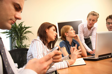 group of five business people working  on project