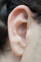 closeup of a man ear in color