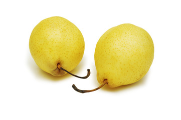 pair of yellow pears isolated on the white