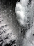abstract snow and ice over flowing waterfall poster