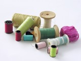several bobbins with colorful cooton threads poster