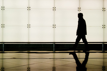 man walking through an airport terminal