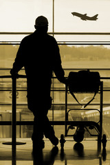man waiting at the international airport terminal
