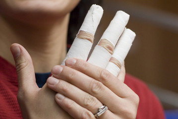 bandage up on fingers of a hand.