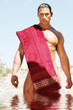 sexy handsome man covered with spa towel
