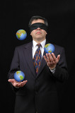 businessman juggling with planet earth poster