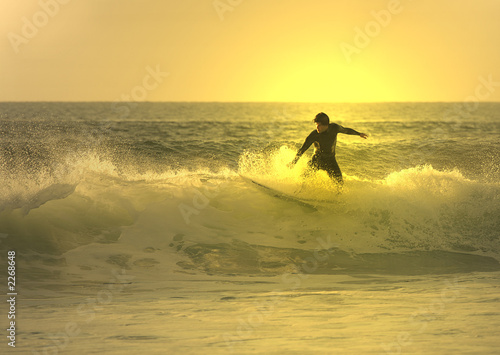 sunset surfer in the wave