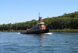 tug pulling a fuel barge thru the cape cod canal. poster