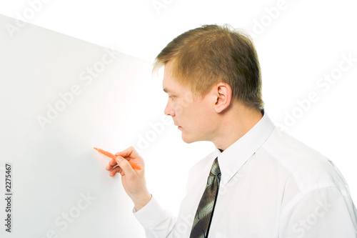 businessman write marker on white desk on white background