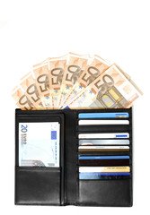 leather wallet with euro bills and credit cards