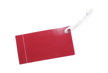 red tag with white cotton thread