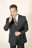 Young business man talking on cell phone poster